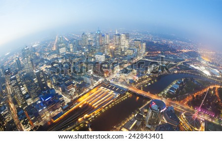 View of Melbourne CBD at twilight with major landmarks in the city including the Flinders Street railway station Melbourne Cricket Ground MCG and Federation Square - stock photo