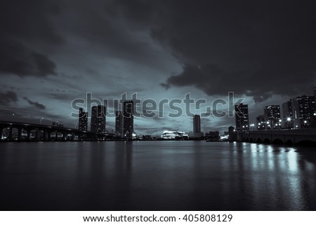 View of Miami Downtown at night time with a view on a bay and  Biscayne . Miami. USA
