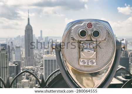 View of Midtown Manhattan New York City with coin-operated telescope on bright sunny day - stock photo