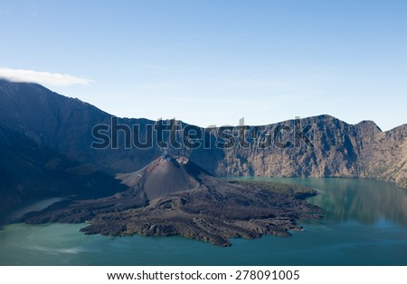 View of mini volcano inside crater lake of Mount Rinjani in Lombok, Indonesia - stock photo
