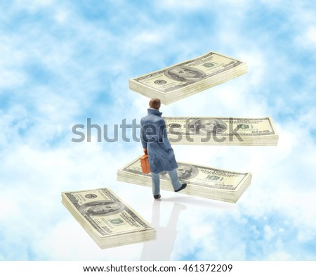 View of miniature toy, businessman walking on dollars on sky.