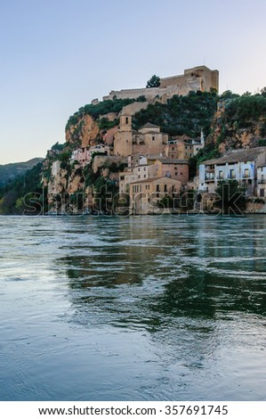 View of Miravet Castle from the riverside of Ebro at sunset in Catalonia, Spain