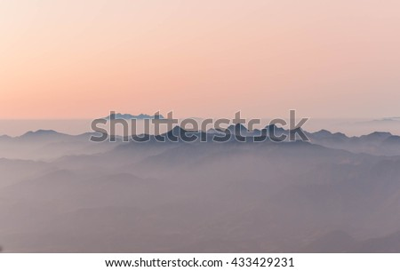 View of mist on the mountain at sunrise over mountain range, at Doi Pha Hom Pok National Park, chiang Mai province, Thailand - stock photo