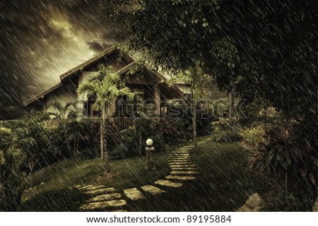 view of  misty summer house during stormy night - stock photo
