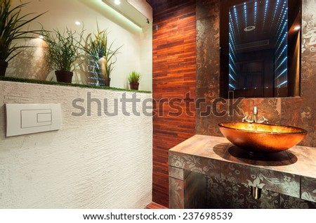 View of modern bathroom in expensive house - stock photo