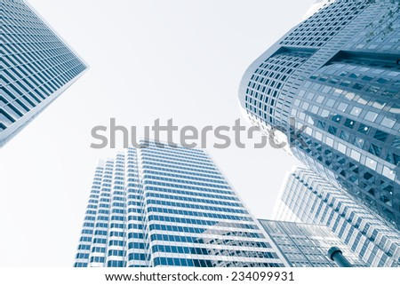 View of modern blue colored building made of glass  - stock photo