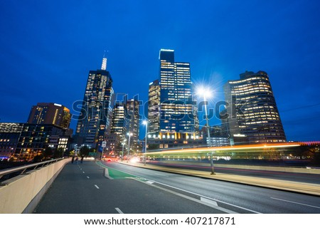 View of modern buildings and traffic trails in Melbourne CBD, Australia at night