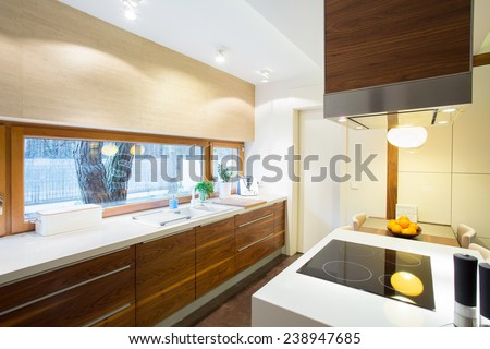 View of modern kitchen inside new apartment - stock photo