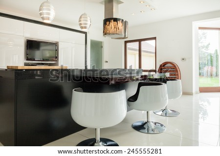 View of modern kitchen with dining area - stock photo