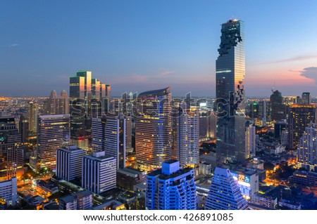 View of modern office buildings, condominium in big city downtown with sunset sky - stock photo