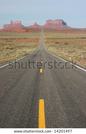 View of Monument Valley in Utah, looking south on highway. Arizona/Utah State line. USA - stock photo