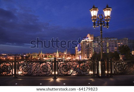 View of Moscow river and Kremlin embankment at the night from Patriarchal Bridge - stock photo