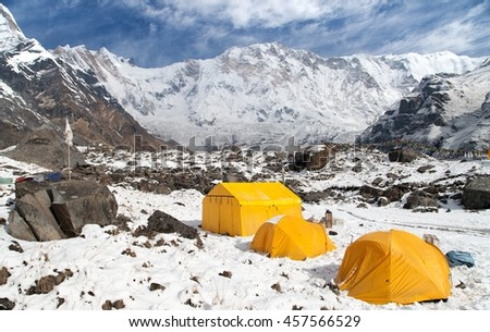View of Mount Annapurna with tents from base camp, Nepal