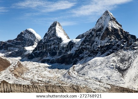 View of mount Cholo, Kangchung peak and Nirekha peak, way to Cho Oyu base camp, Gokyo valley, Sagarmatha national park, Khumbu valley, Nepal - stock photo