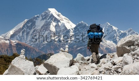 View of mount Dhaulagiri with tourist, great himalayan trail, Nepal - stock photo