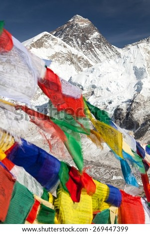 view of Mount Everest with buddhist prayer flags from Kala Patthar, way to Everest base camp, Nepal  - stock photo
