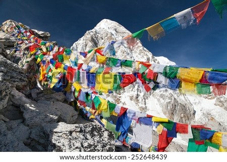 view of Mount Pumo Ri with buddhist prayer flags from Kala Patthar, way to Everest base camp, Nepal  - stock photo