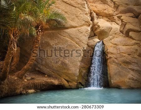 View of mountain oasis Chebika with waterfall, Sahara desert, Tunisia, Africa - stock photo
