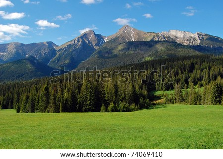 View of mountain peaks in spring time in High Tatras - stock photo
