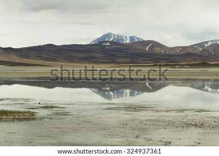 "View of mountains and ""Aguas calientes""  or ""Piedras rojas"" salt Lake in Sico Pass, Chile - stock photo"
