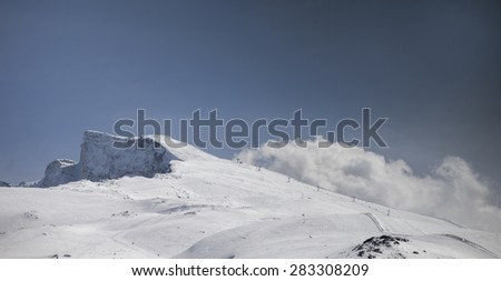 view of mountains and clouds in the sierra nevada, spain - stock photo