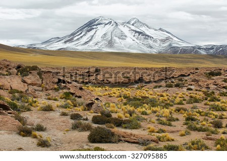 View of mountains and red rock formations in the way to Miscanti and Miniques lagoons in Sico Pass, Chile - stock photo