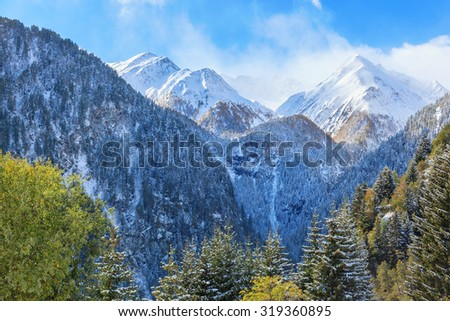 View of mountains with snow and autumn colors