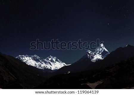 View of Mt. Everest in the Moonlight from the Monastery in the Tengboche at night - Everest region, Nepal, Himalayas - stock photo