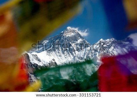 View of Mt. Everest trough prayer flags on summit of Gokyo Ri, Gokyo, Solu Khumbu, Nepal. - stock photo