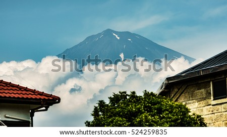 View of Mt.Fuji and clouds over Fujinomiya roofs, Shizuoka, Japan