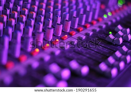 View of music mixer in concert, filled with lights - stock photo