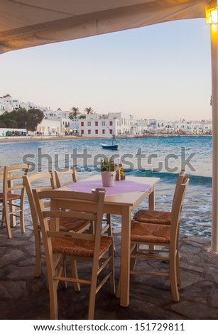 View of Mykonos from cafe at old port. Greece. - stock photo