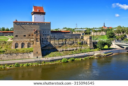 View of Narva Castle, Estonia. Located at the eastern extreme point of Estonia, at the Russian border, on the Narva River. - stock photo