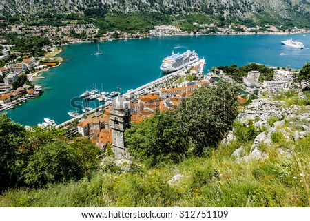 View of Navy Pier with the cruise ship and the rooftops of the old town of Kotor, Montenegro - stock photo