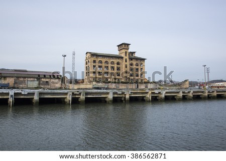 view of Nervion river and old industrial port area at the entrance to Bilbao,Spain