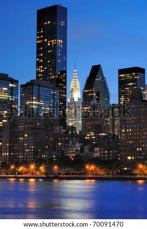 View of New York City skyline including Chrysler Building. - stock photo