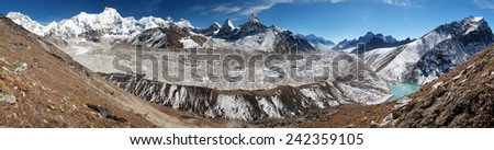 View of Ngozumba glacier, the largest glacier in great Himalayan range and Everest, Lhotse and other mounts - way to Cho Oyu base camp - Nepal - stock photo