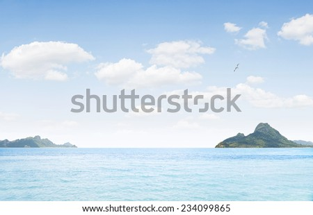 view of nice  blue ocean  with tropical islands in the distance - stock photo