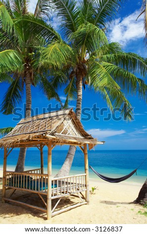 view of nice exotic bamboo hut on tropical beach