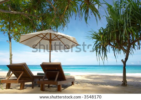 view of nice exotic tropic beach early in the morning - stock photo