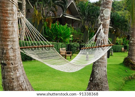View of nice hammock hanging between two Coconuts ,Koh Kood, Trat Province ,Thailand - stock photo