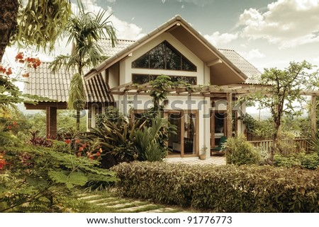 View of nice  stylish summer  villa in  tropic  environment - stock photo