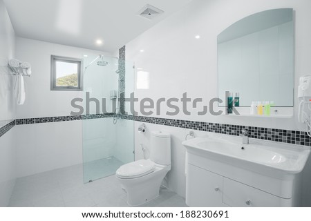 view of nice white tiled modern restroom - stock photo