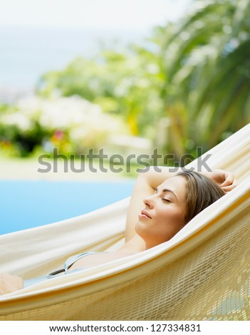 view of nice young lady in hummock - stock photo