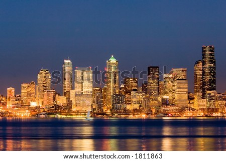 View of nighttime Seattle across Puget Sound - stock photo