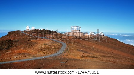 View of observatories from summit of Haleakala volcano in Maui island, Hawaii - stock photo