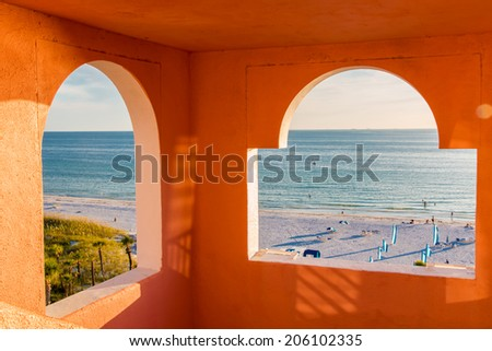 View of ocean and beach framed by windows