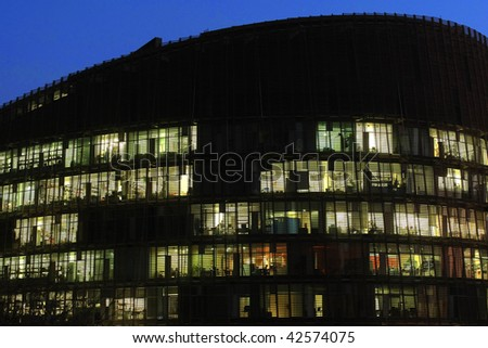 View of office building interior illuminated at night