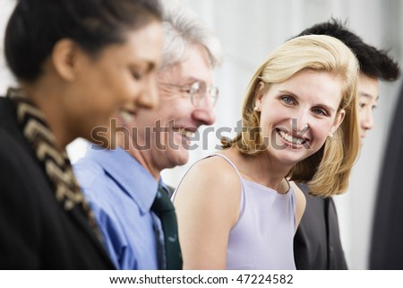 View of office executives smiling.