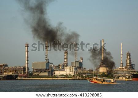 view of oil refinery industry plant in the evening.